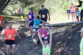 Runners maneuver down a steep grade onto Shoreline Highway during the 108th Dipsea race in Stinson Beach, Calif. on Sunday, June 10, 2018. The scenic 7.4 mile course from Mill Valley to Stinson Beach was first run in 1905 and is the the oldest trail race in America. (Sherry LaVars/Special to the Marin Independent Journal)